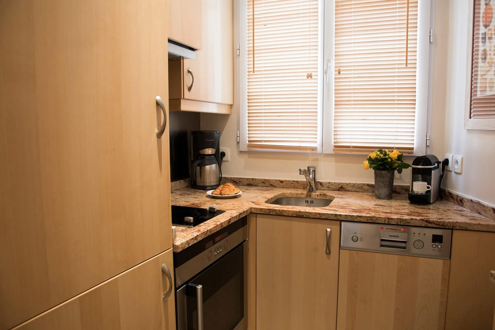 Prepare gourmet meals in the fully equipped, modern kitchen.