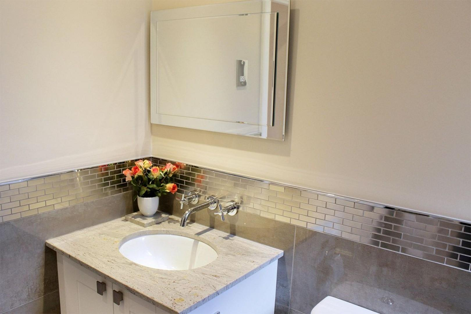 Sink with marble top and vanity mirror