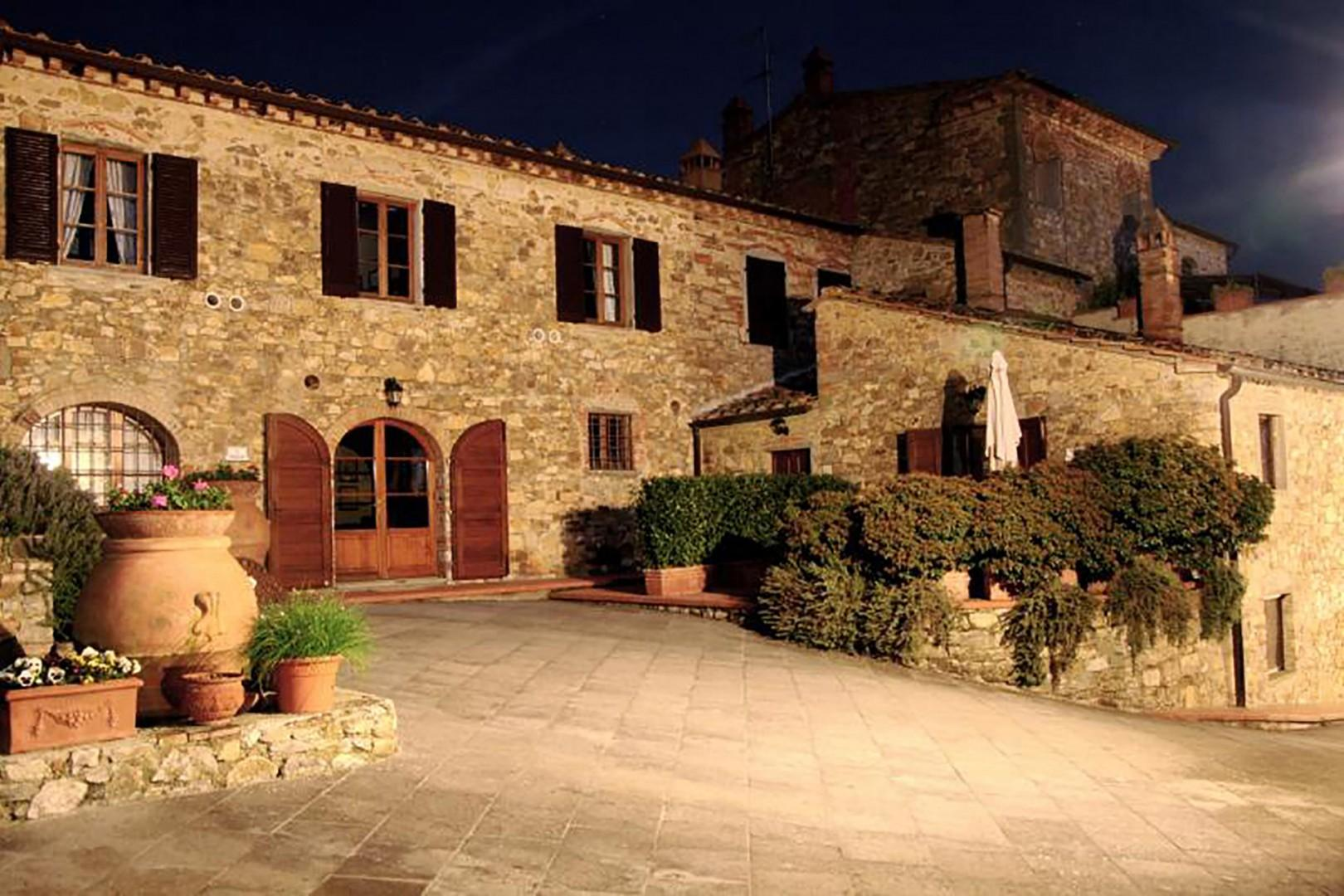 Evening view of the entrance of the Poggio apartment.