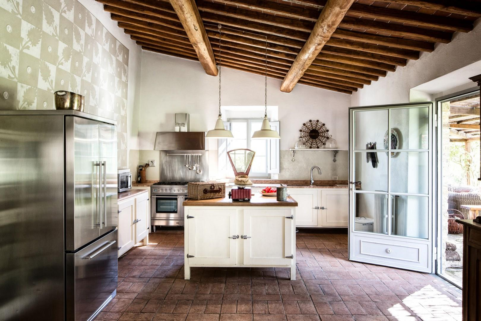 Farm-style kitchen is fully equipped.