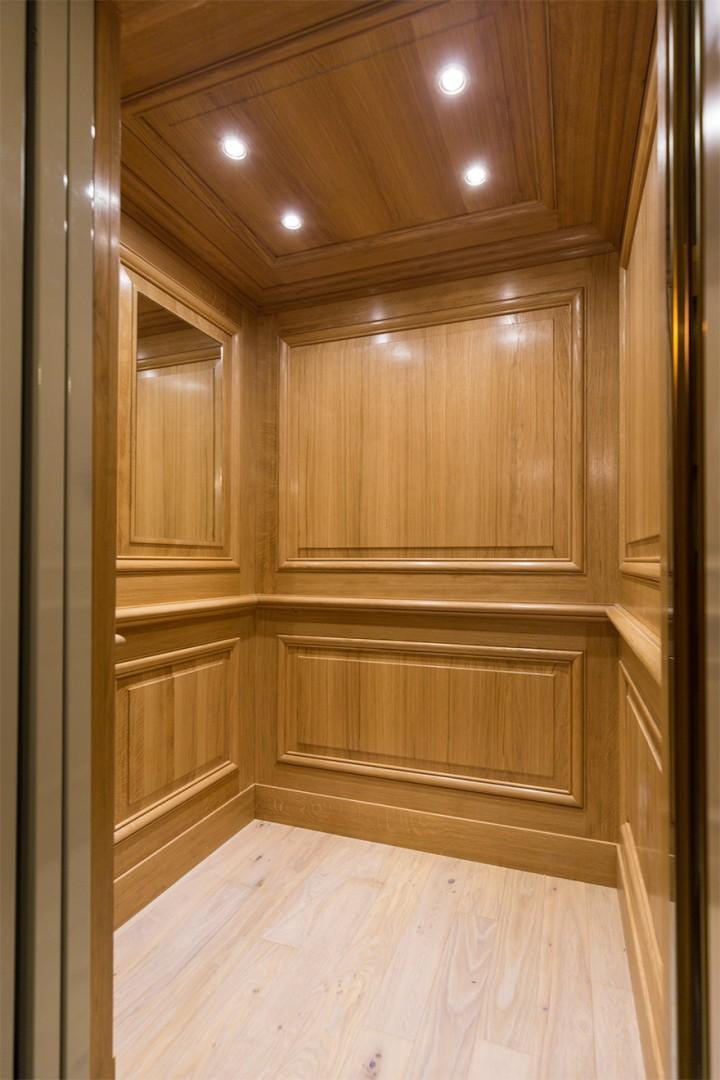The modern elevator that can accommodate two guests and two suitcases.