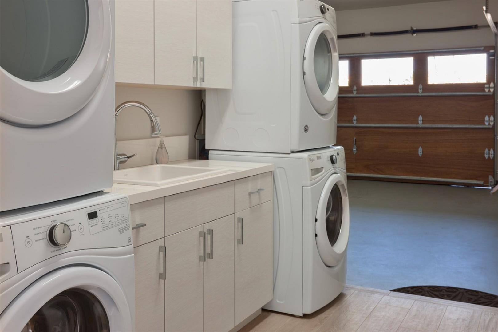 Second and third washer and dryer set in the garage with an additional sink. All laundry supplies are provided!