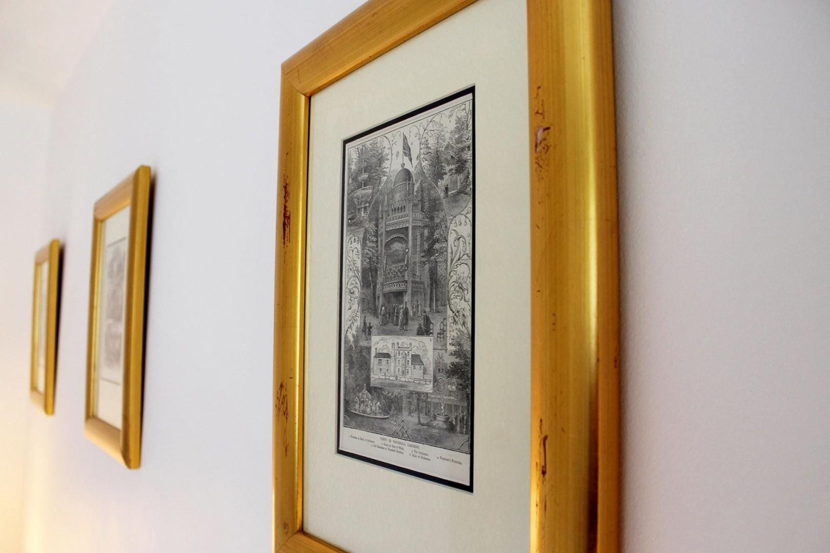 Lovely framed pictures in the first bedroom