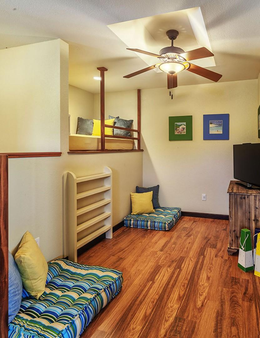 Kids area off twin rooms. Twin bed in reading loft.