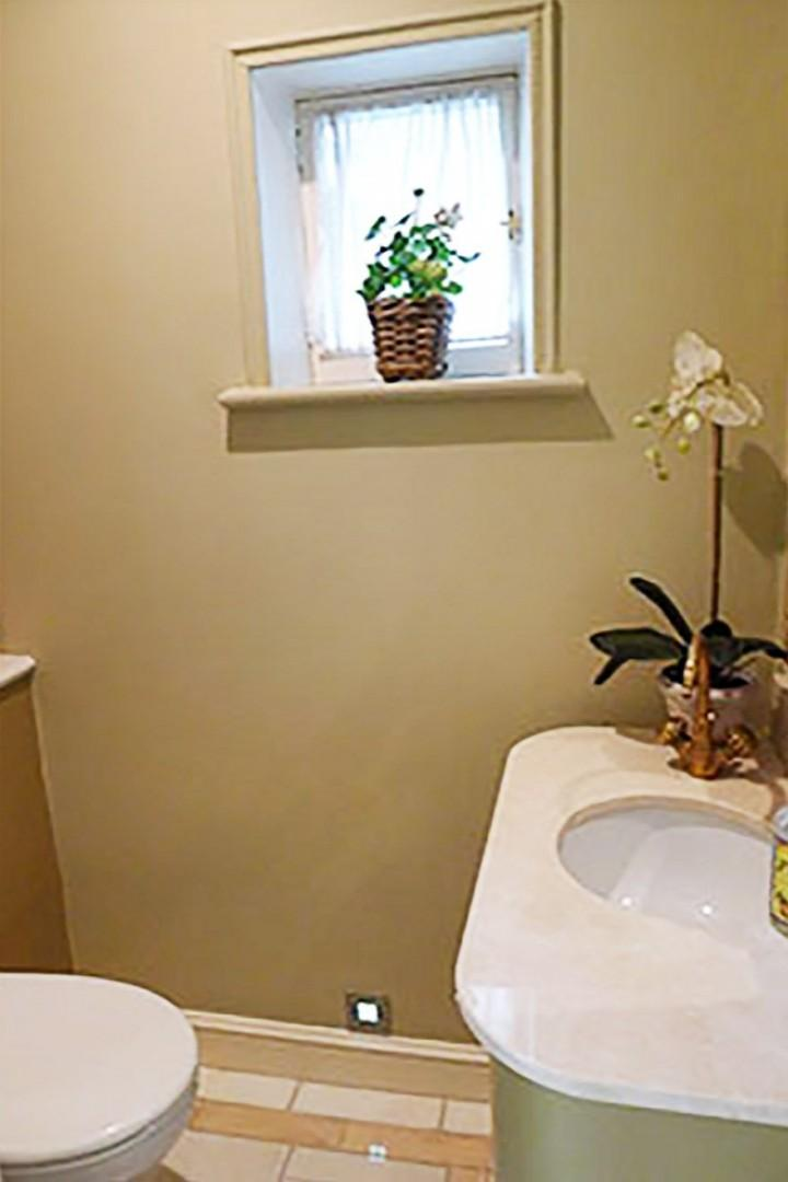 Half bath with toilet & sink located off the entrance hall