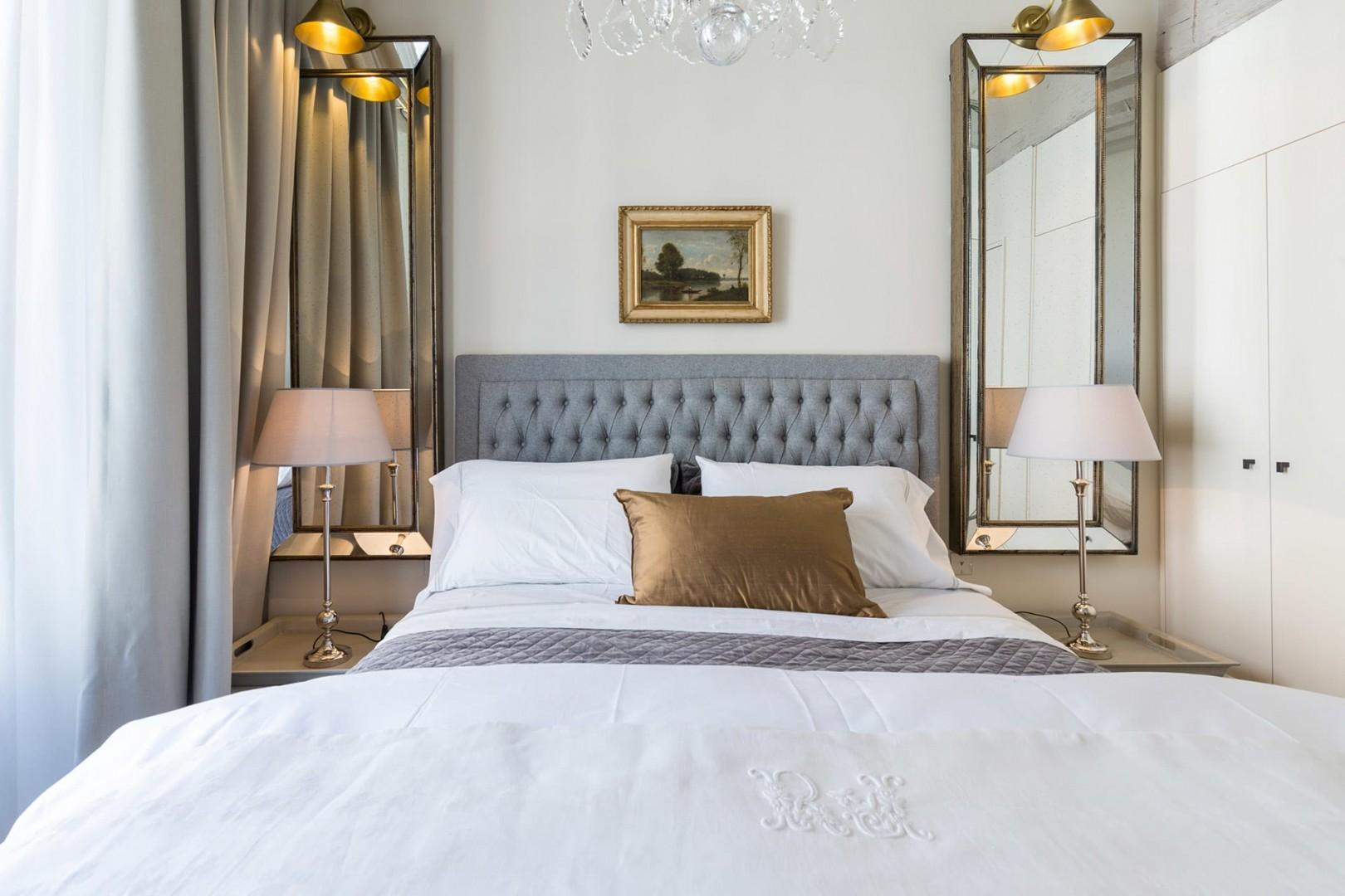 Get a good night's sleep in the large, sumptuous bed.