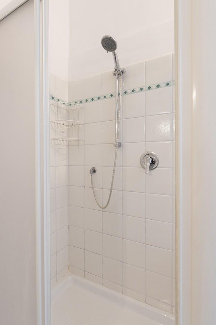Good-sized shower in bathroom.