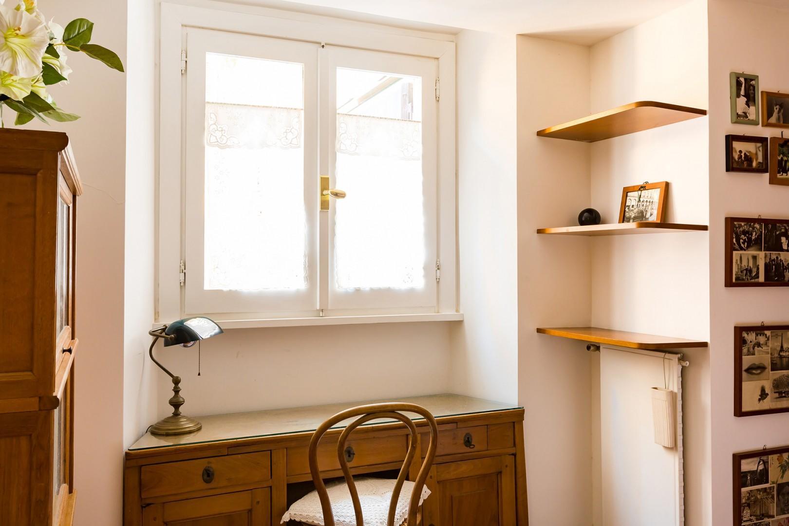 Window and desk in bedroom 1.