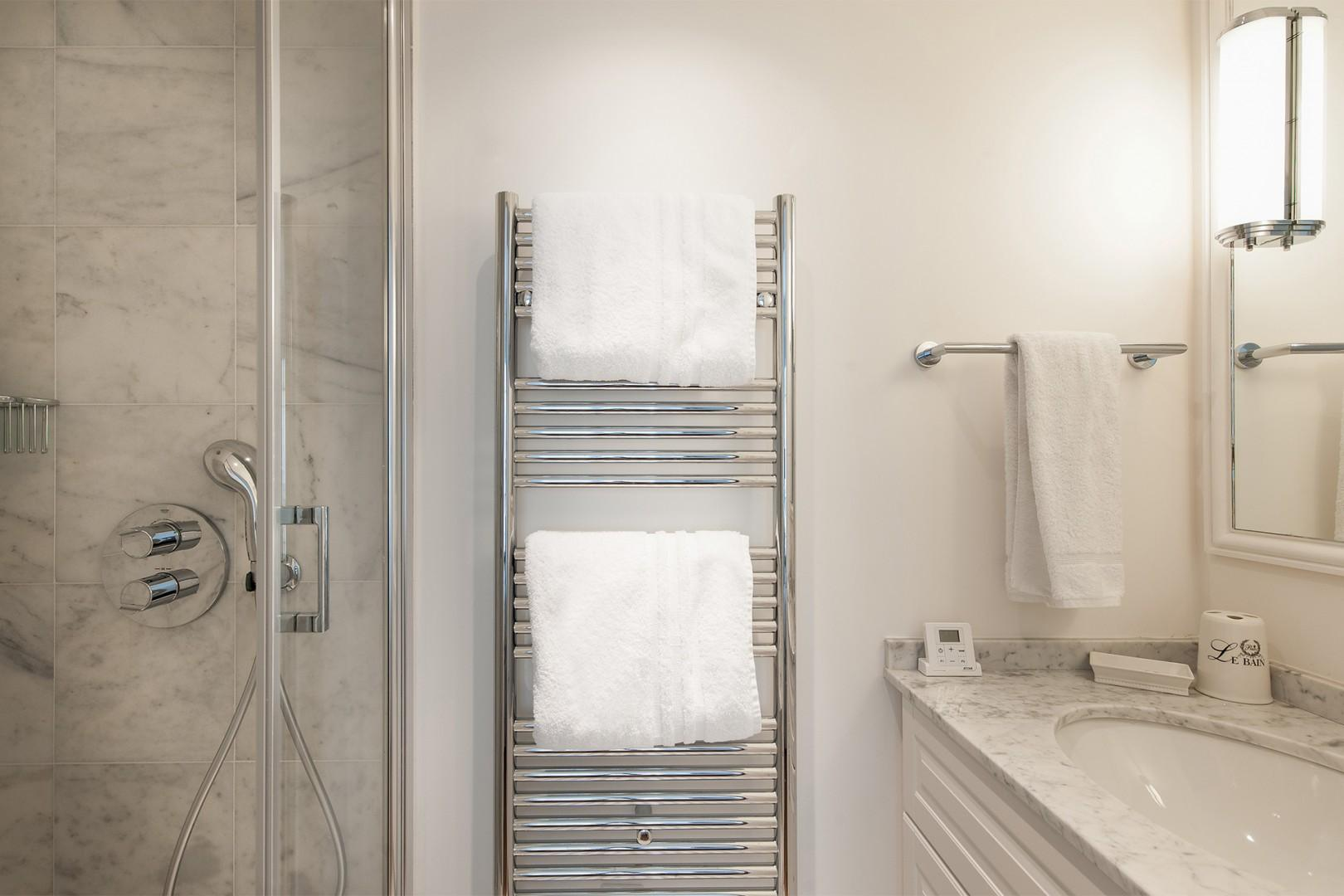 The heated towel rack lets you stay warm after your shower.