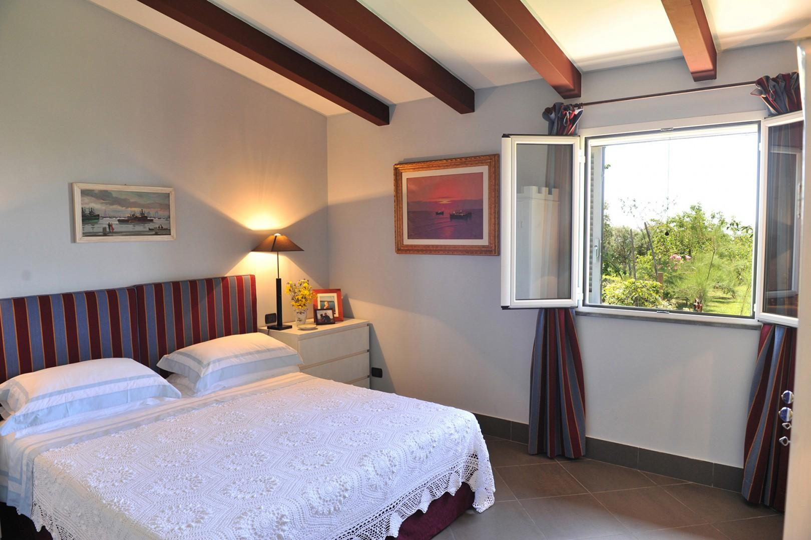 Beamed ceilings in bedroom 1. All 3 bedrooms have beds that can be prepared together or apart.
