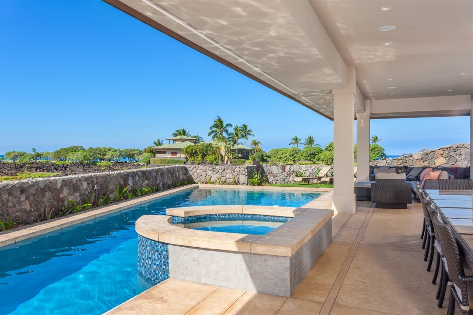 Pool, spa and outdoor dining area.