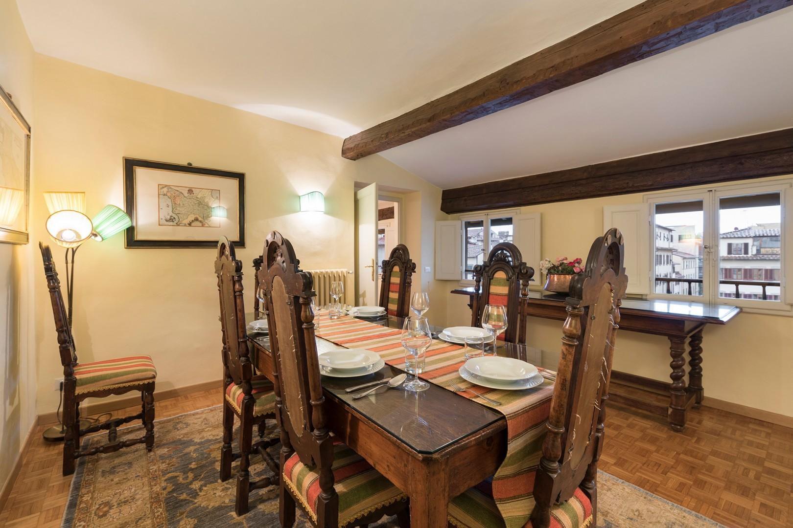 Tuscan wood dining table can seat 8 to 10 people.