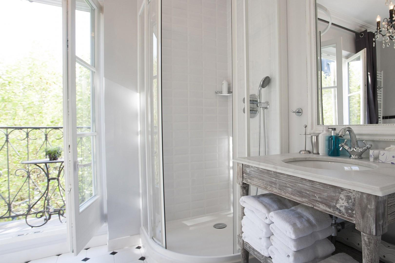The bright bathroom also features a large shower.