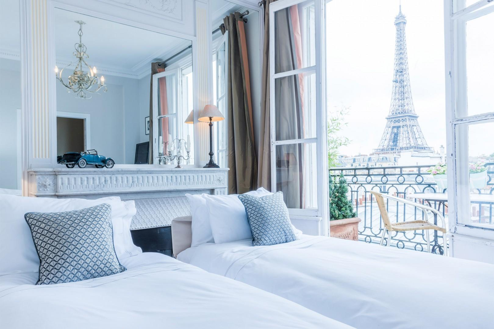 View of the Eiffel Tower from the high-quality sofa that converts into two beds.