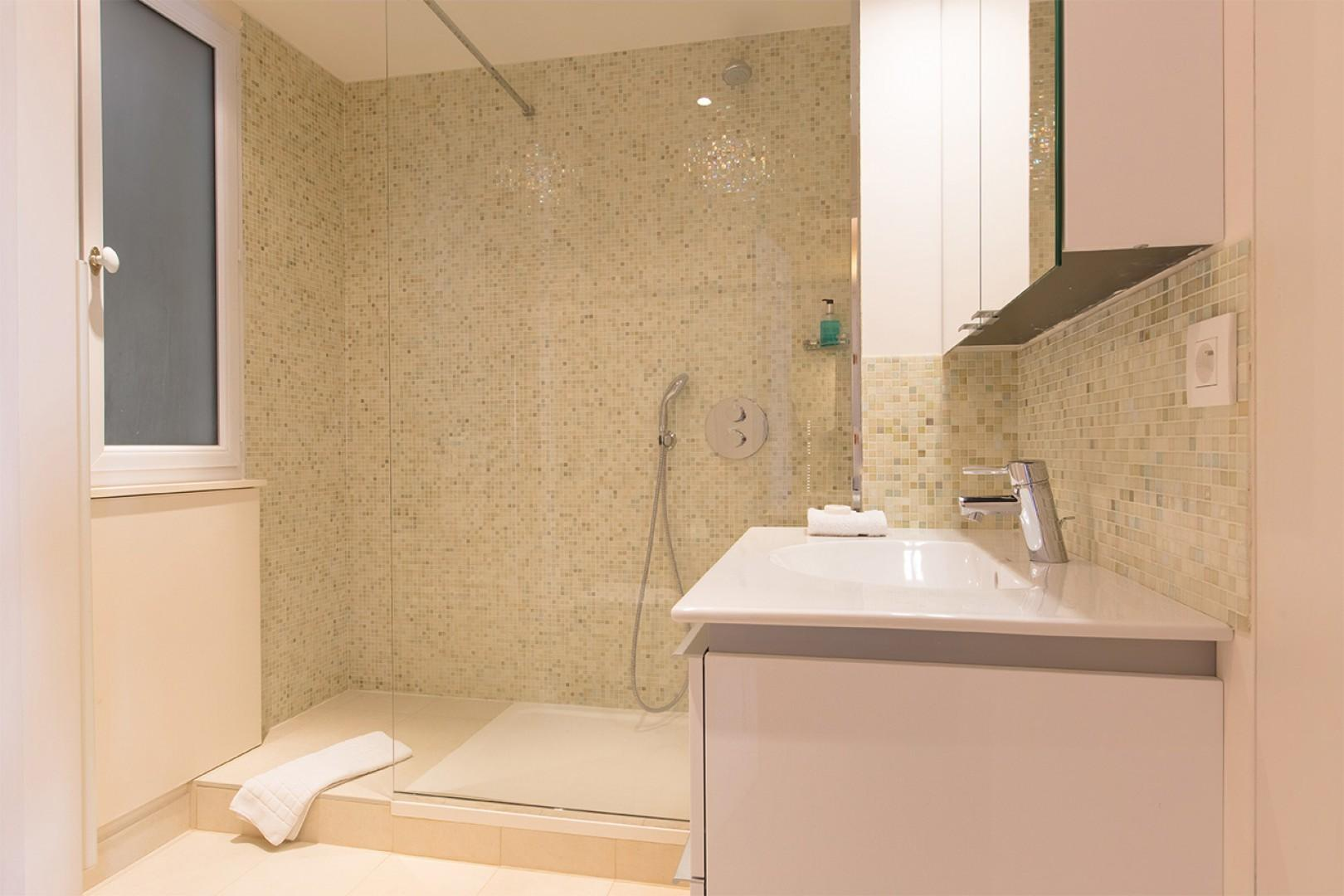 The spacious bathroom 1 comes with a shower, sink and toilet.