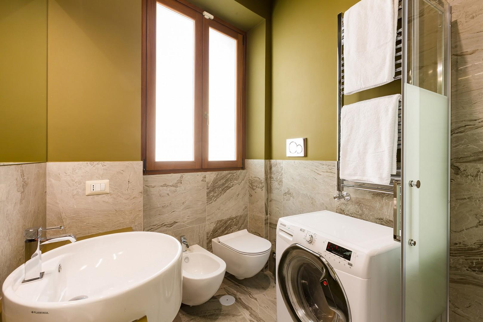 Bathroom 2 has a combination washer and dryer.
