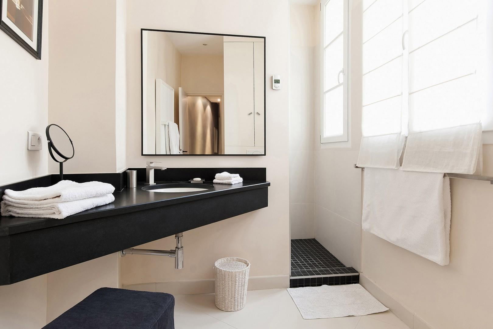 Start your day in this modern and sunny bathroom.
