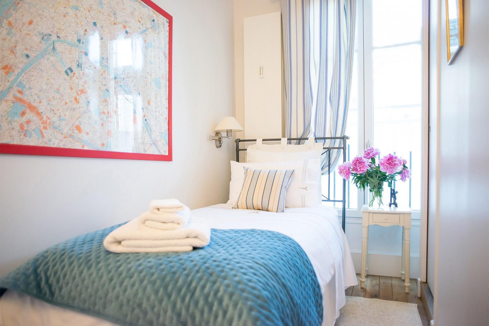 Bedroom 3 sleeps one person and has a private, en suite bathroom.