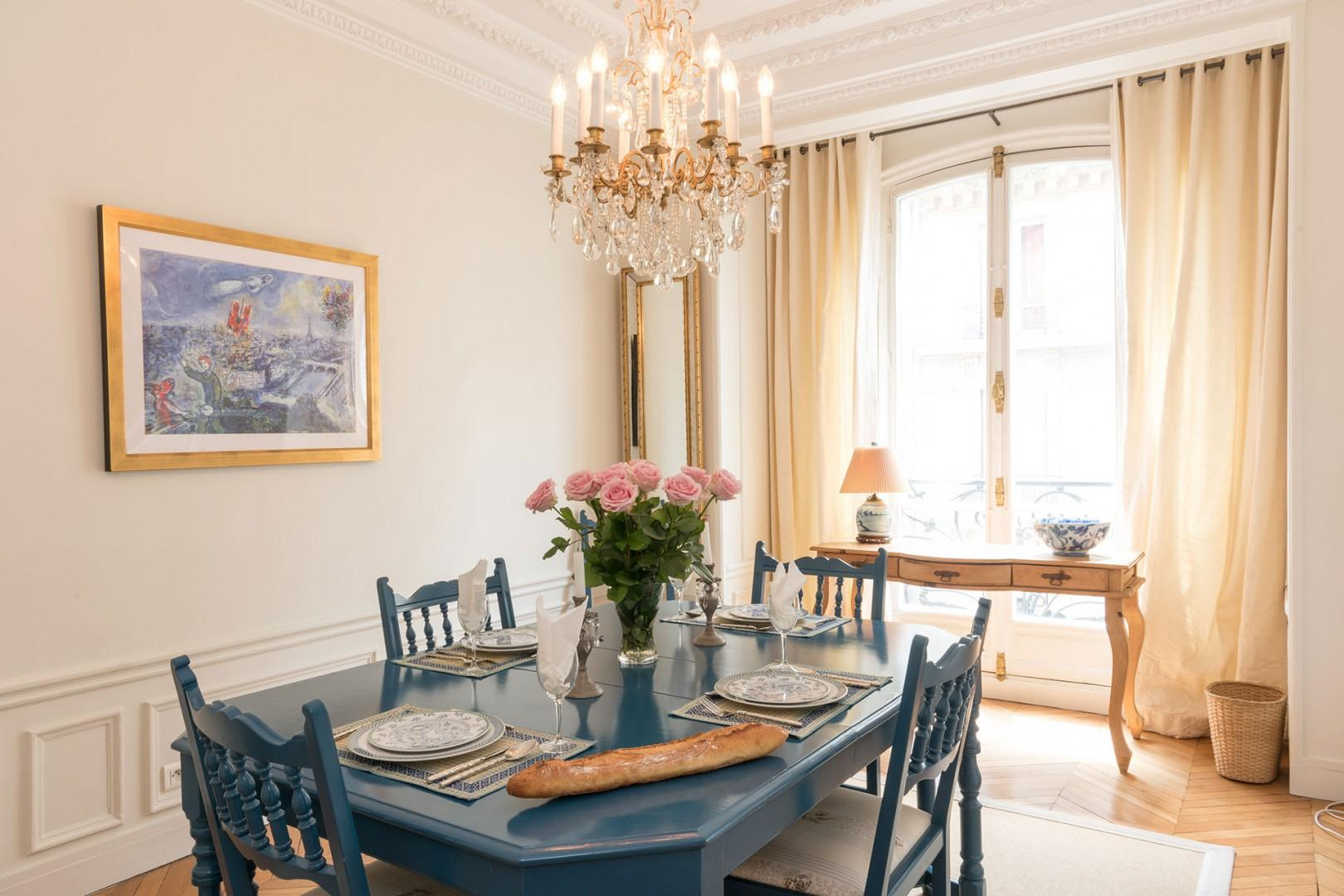 The country-style dining table comfortably seats six guests.