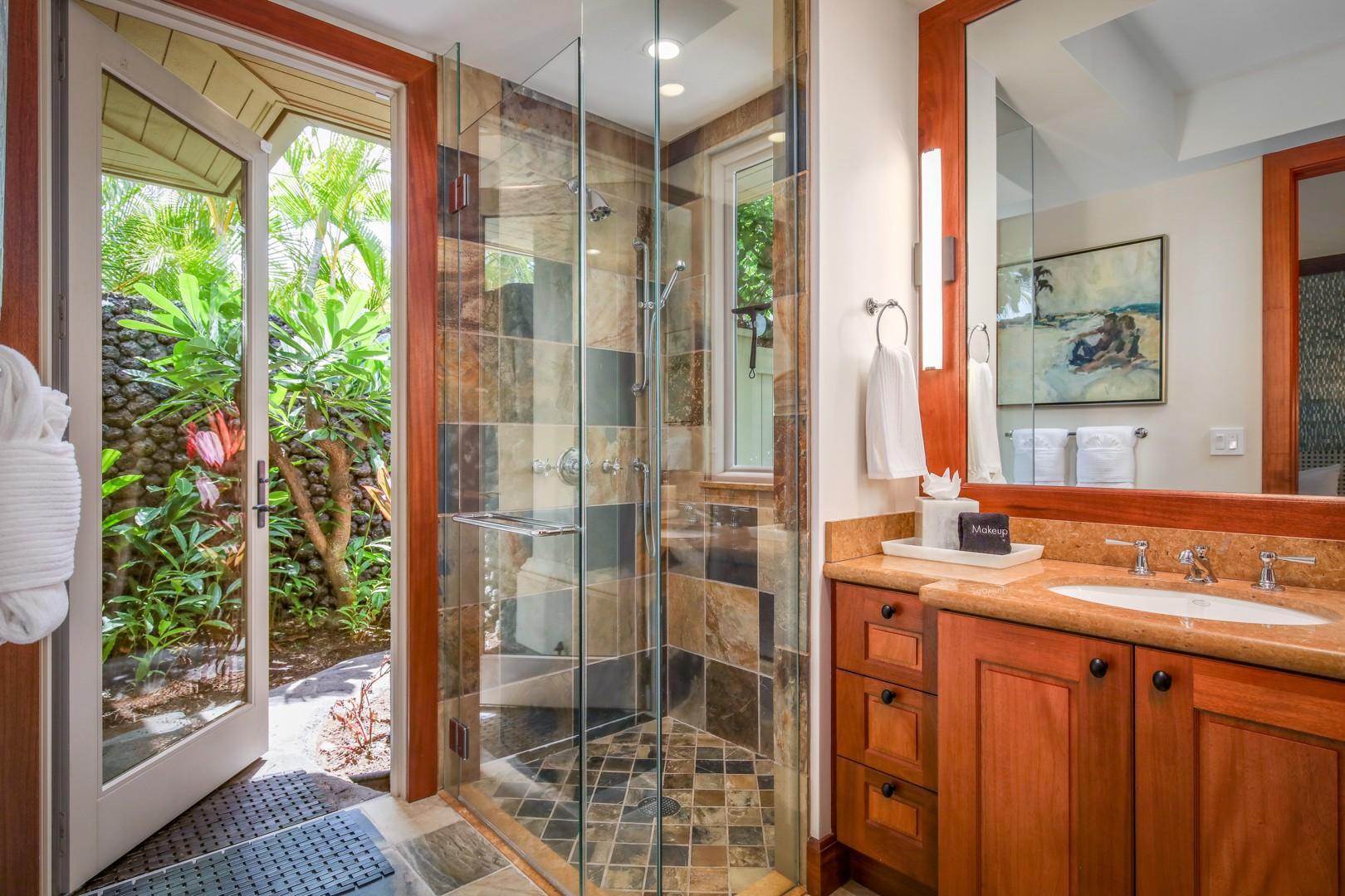 Full en suite bath in Guest Room 3 with walk-in shower and outdoor shower garden.