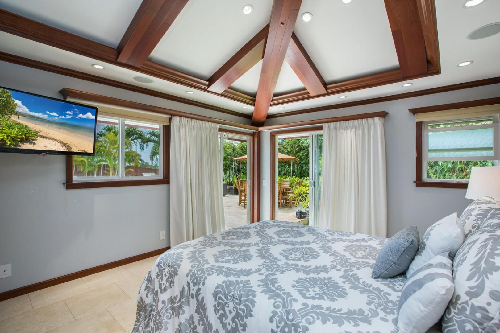 The first-floor master bedroom (not to be confused with the second-floor master!) has sliders to the pool deck and yoga lawn, a high-density television, and an en suite bathroom.