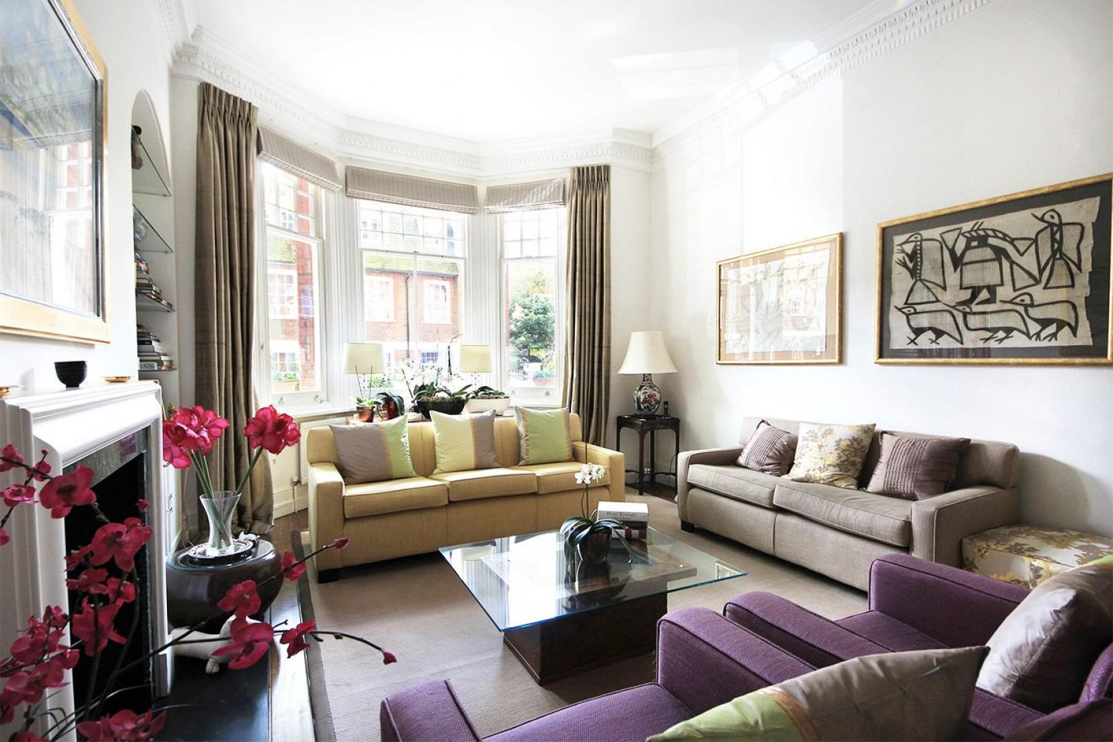 Beautifully decorated living room with large bay window