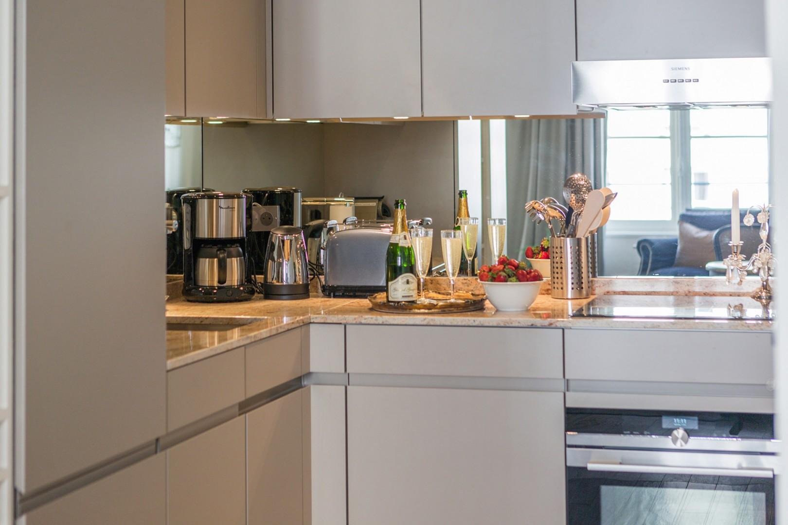 The fully equipped kitchen has everything to prepare home-cooked meals.