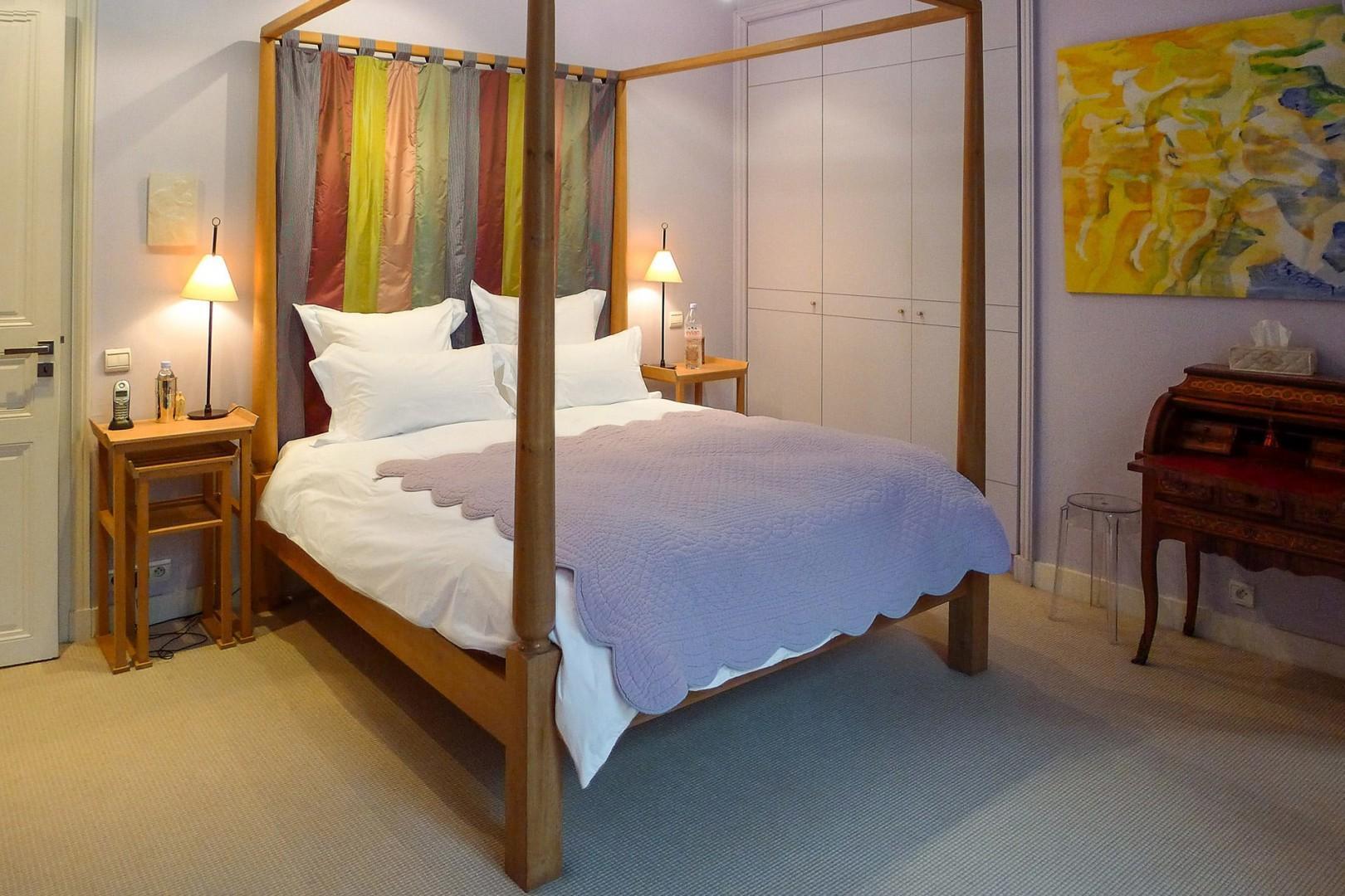 Bedroom 2 comes with a comfortable bed and en suite bathroom.