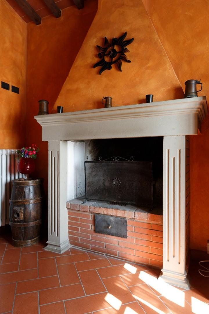 Kitchen has an original wood burning fireplace.