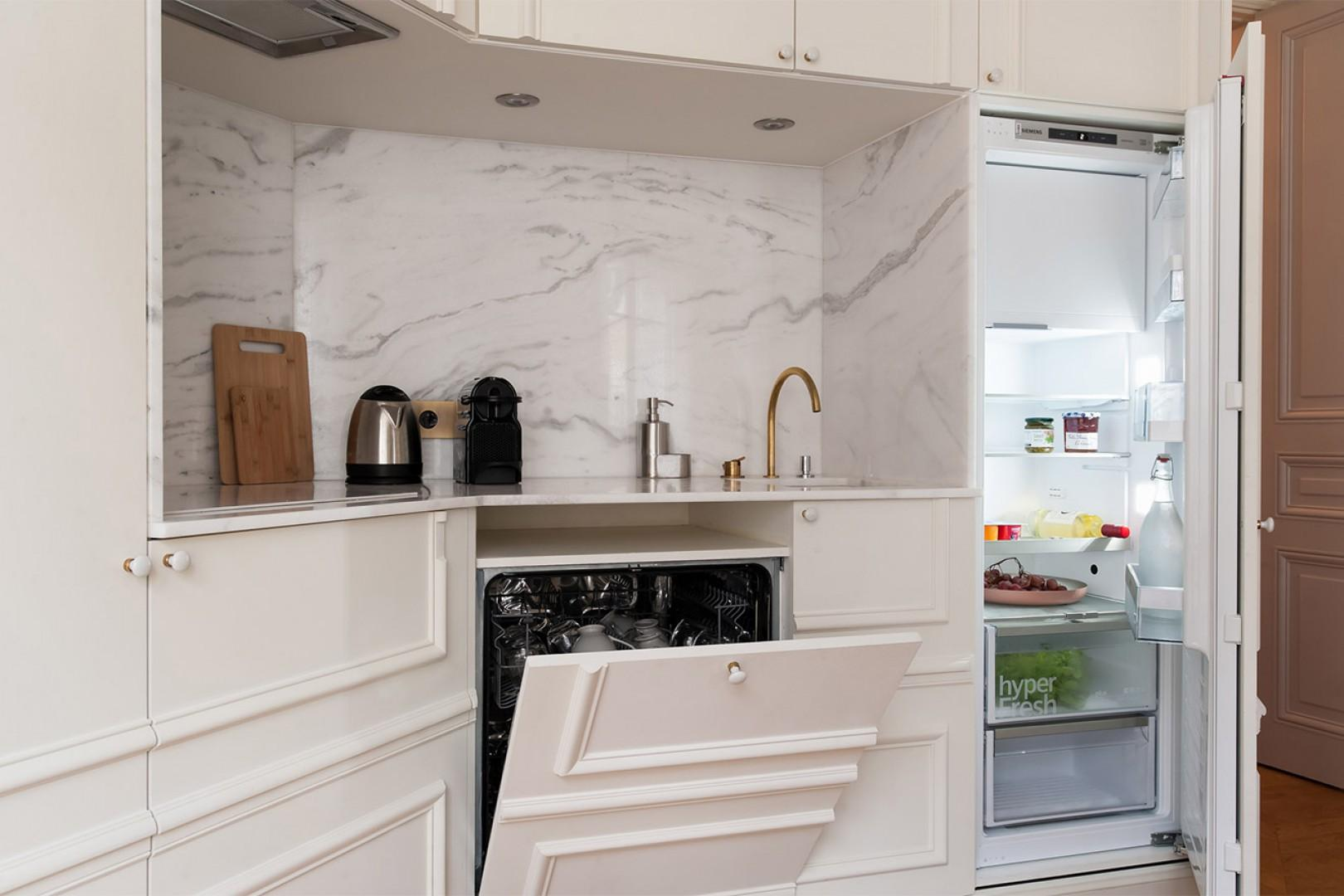 The kitchen comes with all the appliances you need for a comfortable stay.