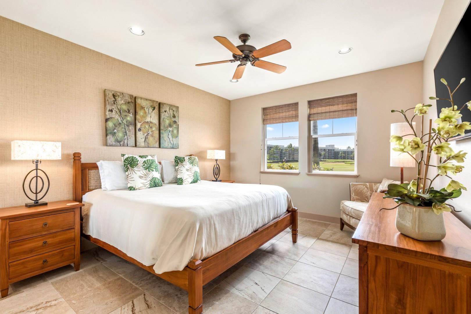 Master bedroom with king bed, flat screen TV, ocean and golf course views and en suite bath.