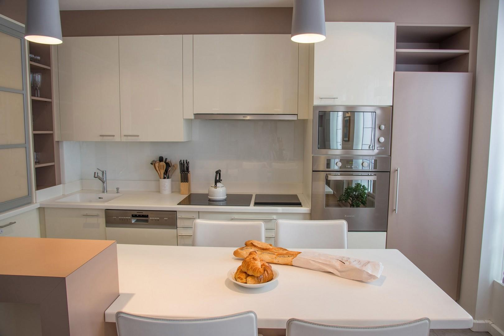 The eat-in style kitchen provides a comfortable place to enjoy casual meals.