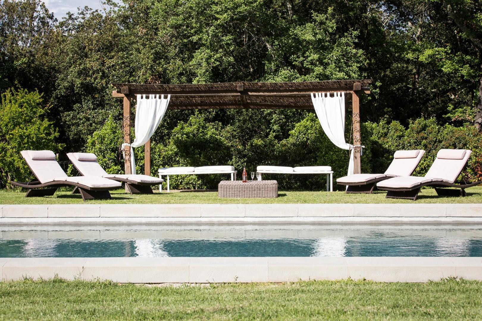 Shady pergola by the pool.