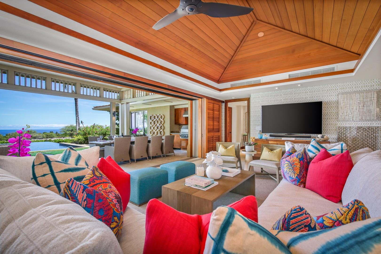 Living area with vaulted ceilings and bold beautiful fabrics and colors.