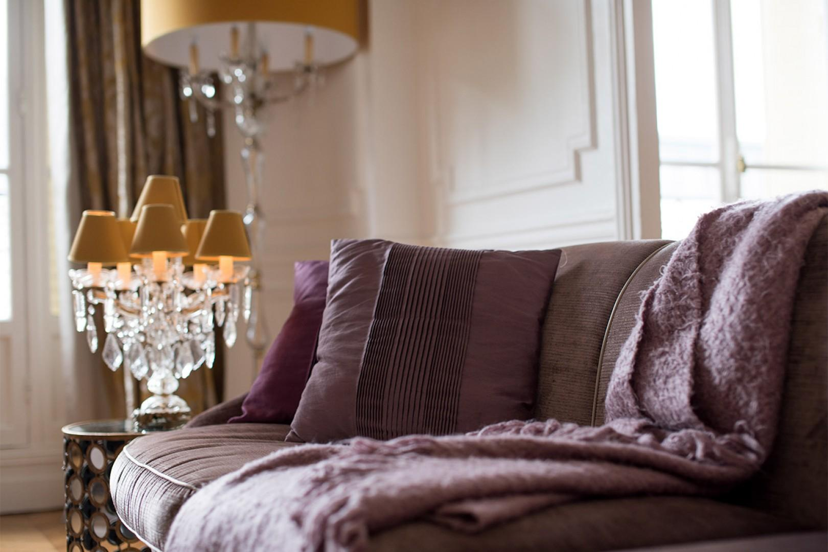 The comfy couch is perfect for relaxing after a long day exploring Paris.
