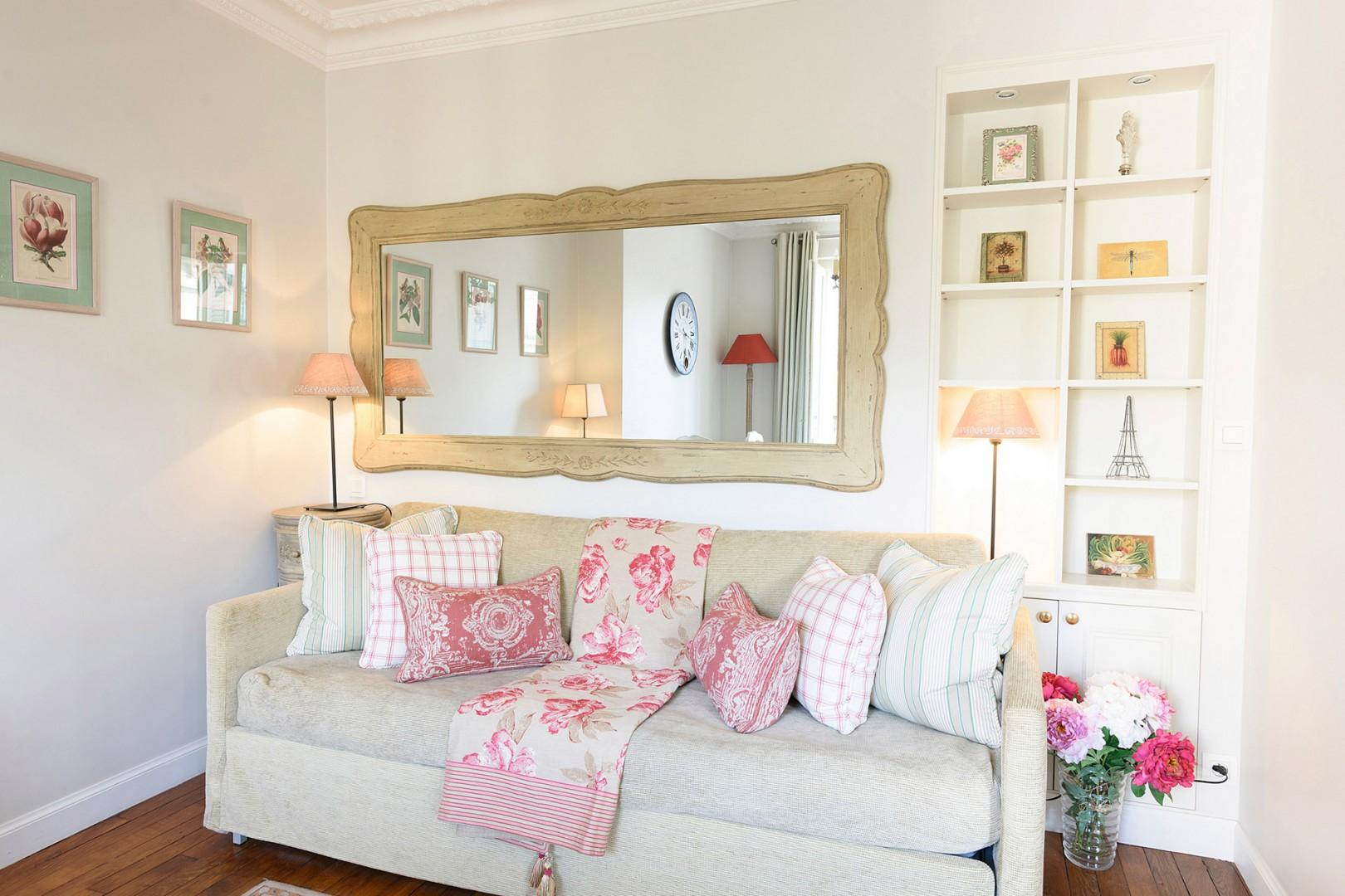 The separate seating area has a comfortable sofa with trundle that converts into two beds.