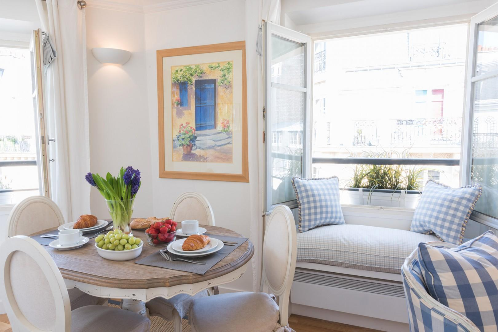 Relax with a book or magazine in the charming window seat.
