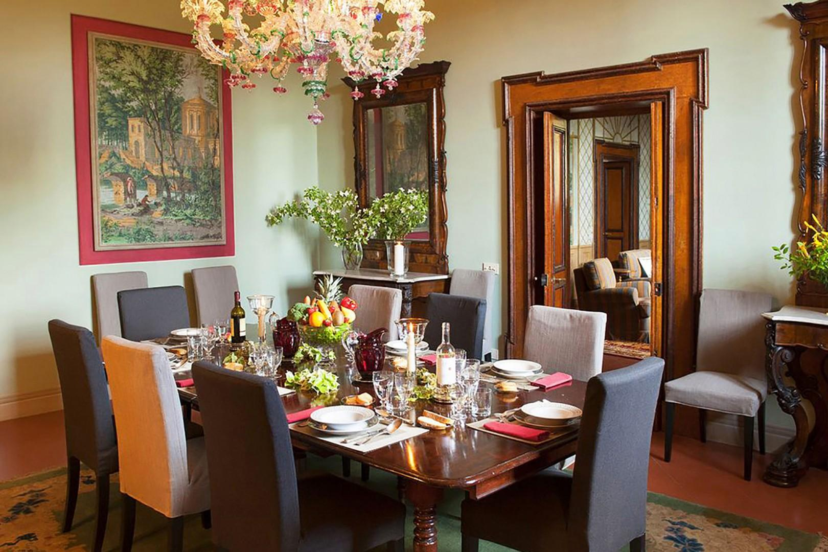 Dine in style in the elegant dining room with gorgeous Venetian glass chandelier.