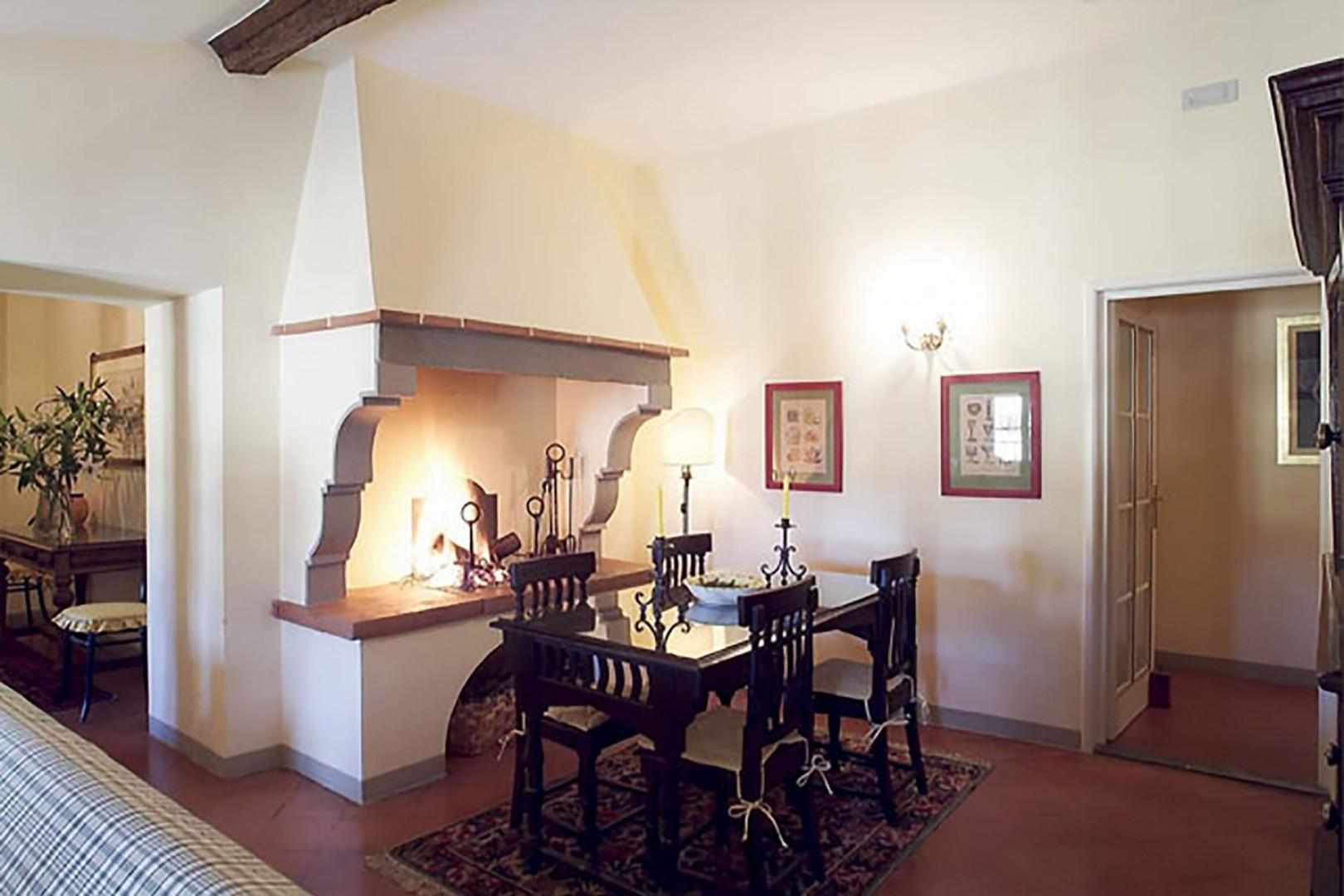 Original wood fireplace in the dining area adds character and charm.
