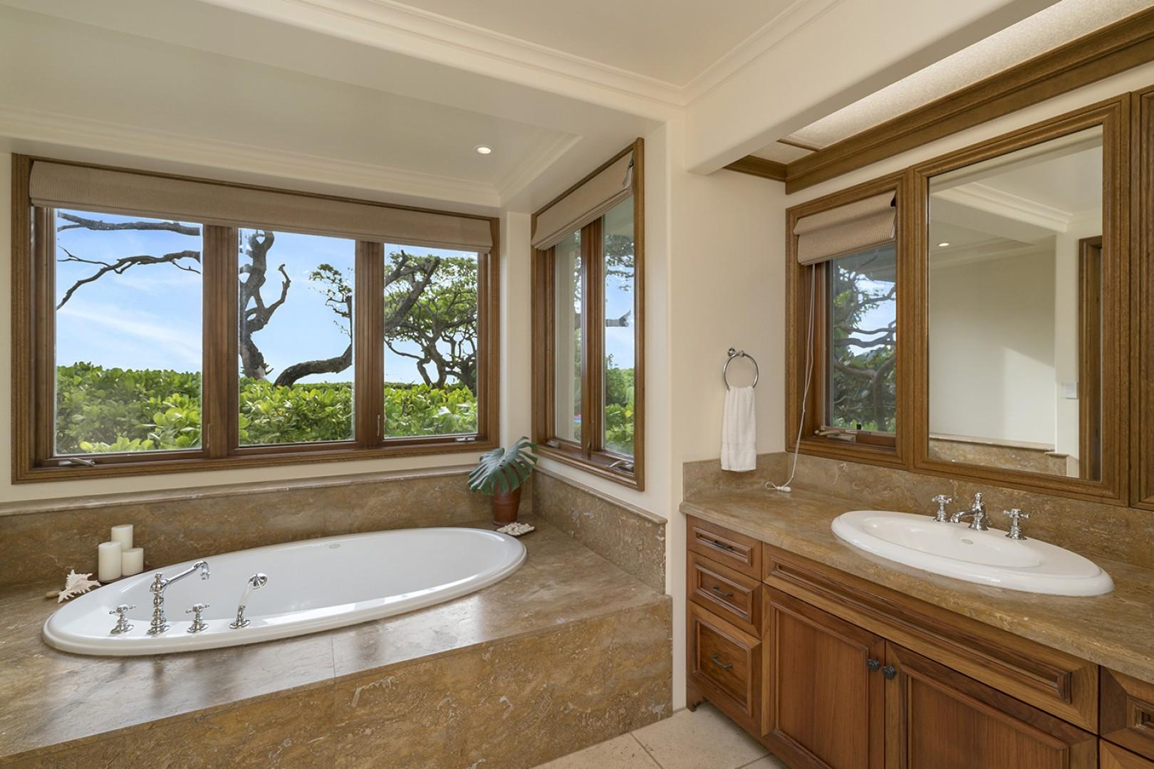 Main house: Guest Bedroom 2 ensuite with jetted tub and walk in shower.