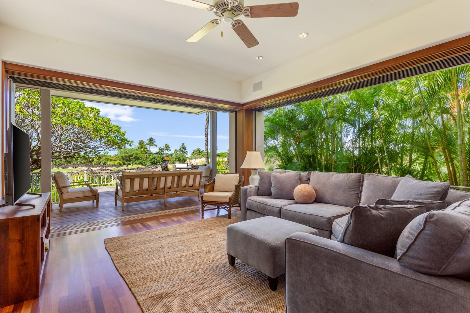 Alternate view of bonus room featuring views of lower lanai and floor to ceiling sliding glass pocket doors.