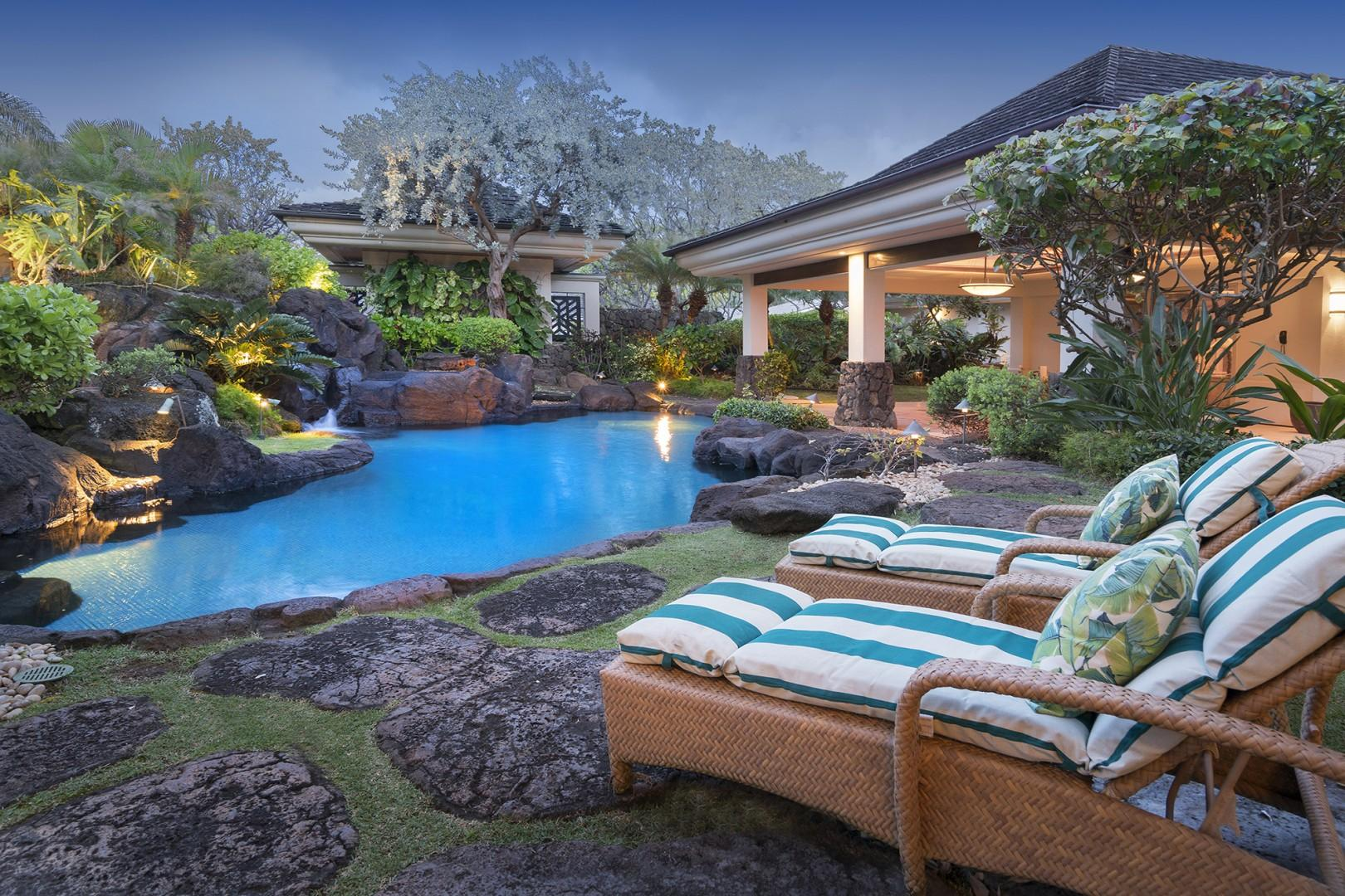 Tropical lagoon style pool and spa with natural rocks and cascading waterfalls.