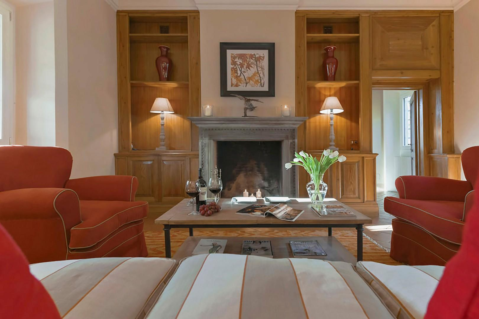 Handsome living room with fireplace and warm wood book shelves.