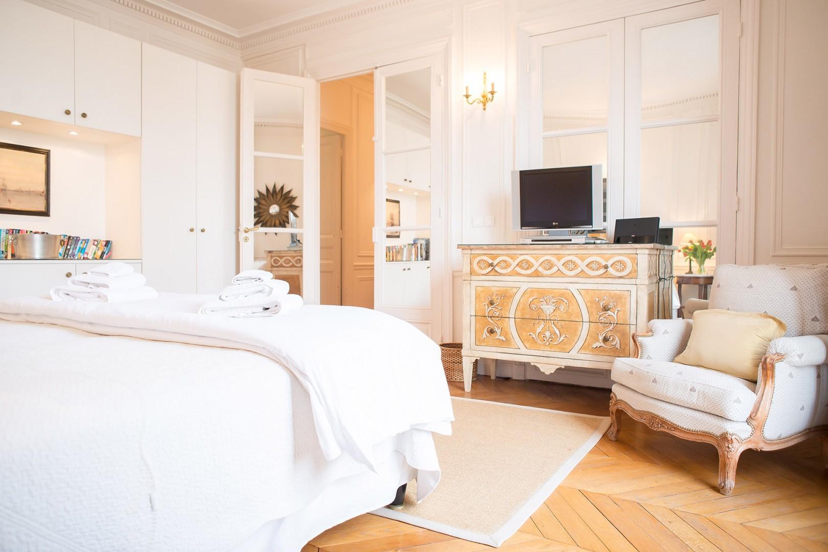 The oversized French door brightens the bedroom.