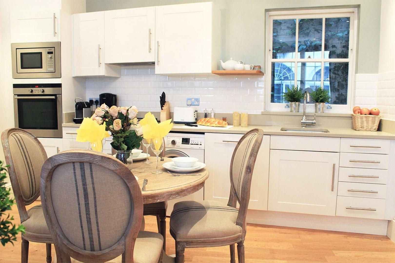 Beautifully remodeled kitchen and dining area of mews home