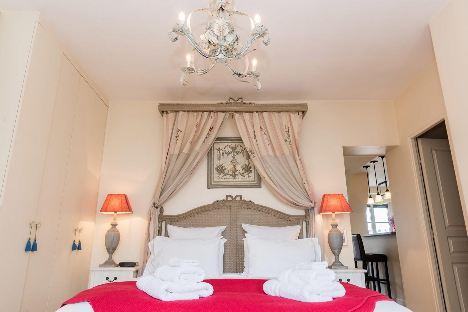 Relax in the spacious bedroom with a romantic canopy bed.