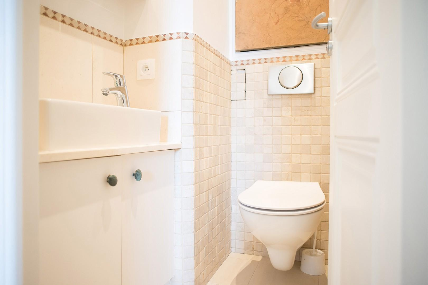 There is a separate half bath with a toilet and sink.