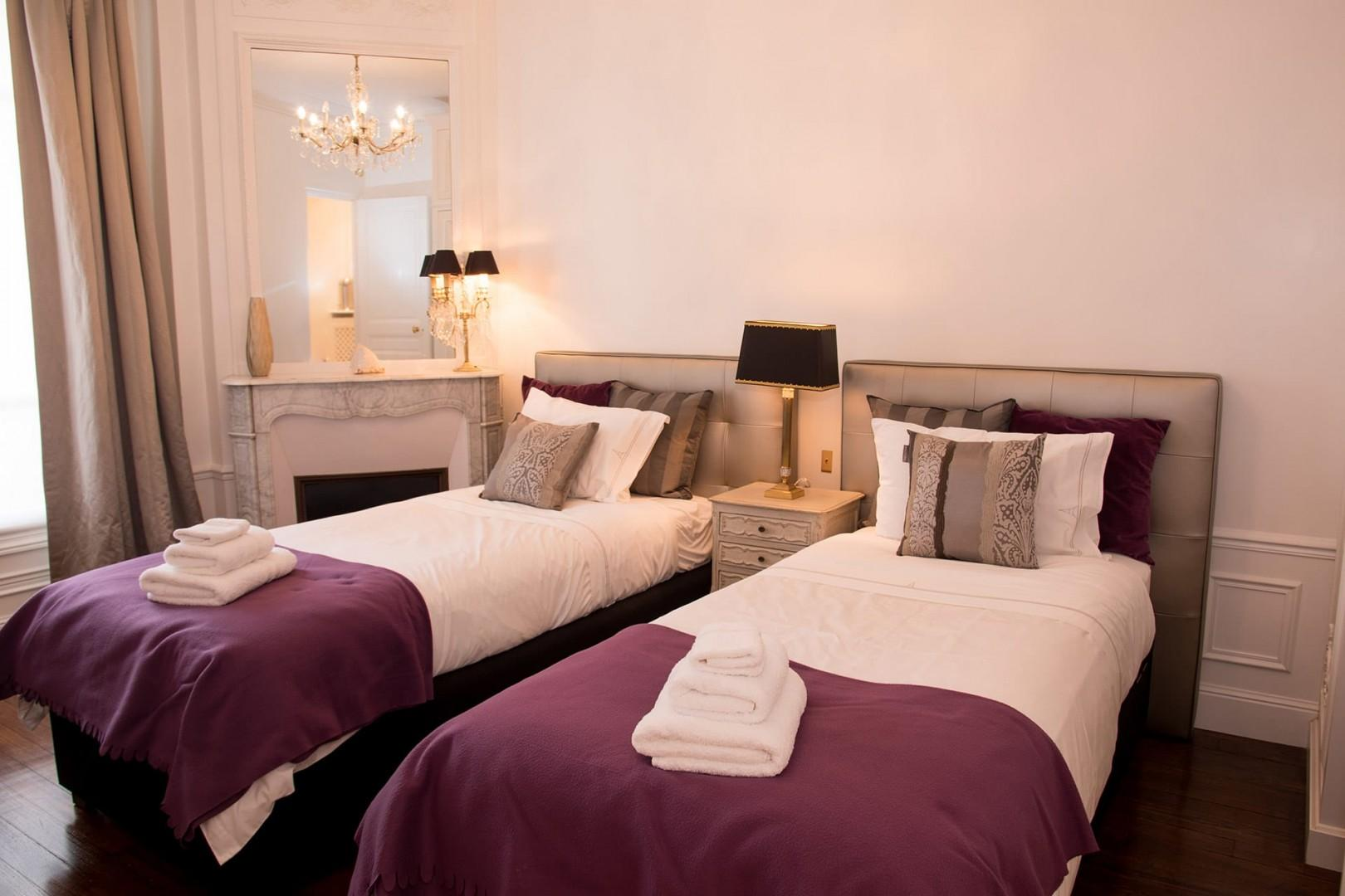 Bedroom 2 has two comfortable beds and a private en suite bathroom.
