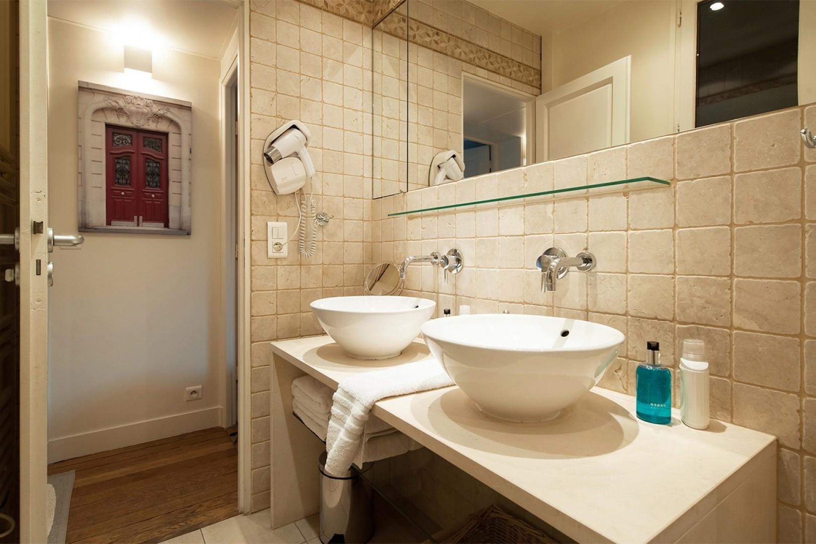 You will love the modern finishes in the bathroom.