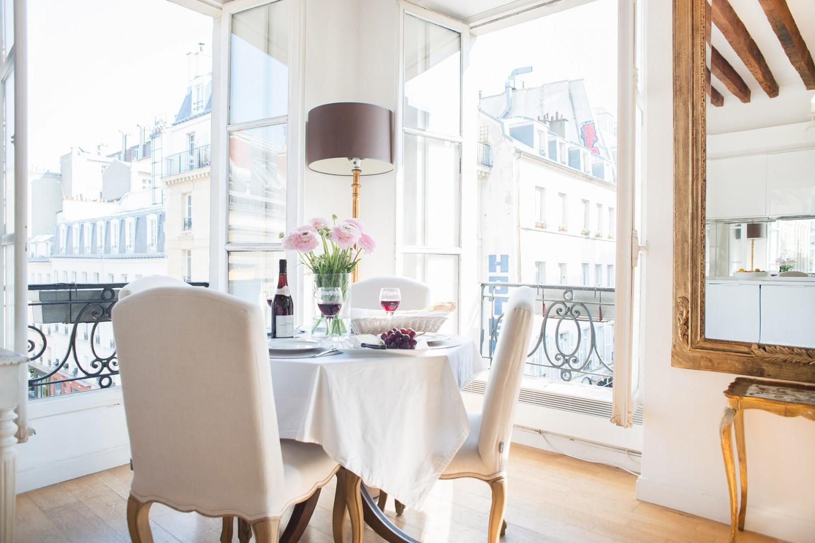 Start your day with a French breakfast and stunning views of Paris!